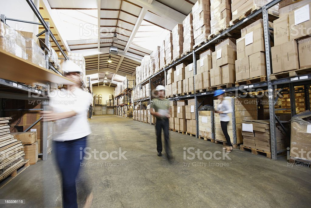 Workers at the wholesale and retail warehouse depot royalty-free stock photo