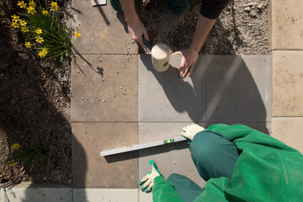 workers build a stone path in a garden stock photo
