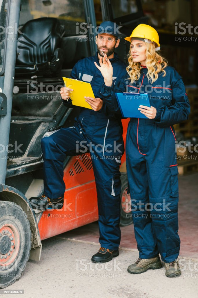 Workers by the forklift royalty-free stock photo