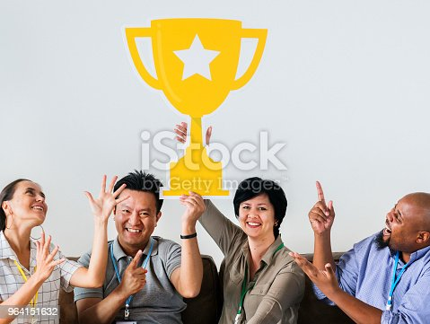 istock Workers celebrating their success with a trophy 964151632