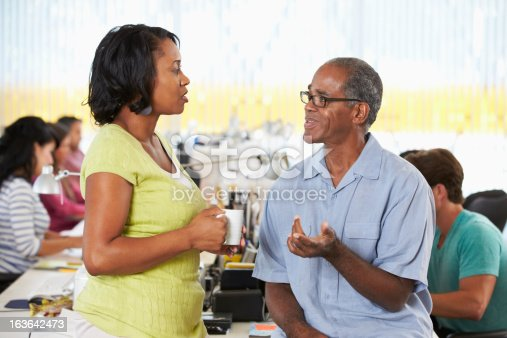 862201618 istock photo Workers Chatting In Creative Office 163642473