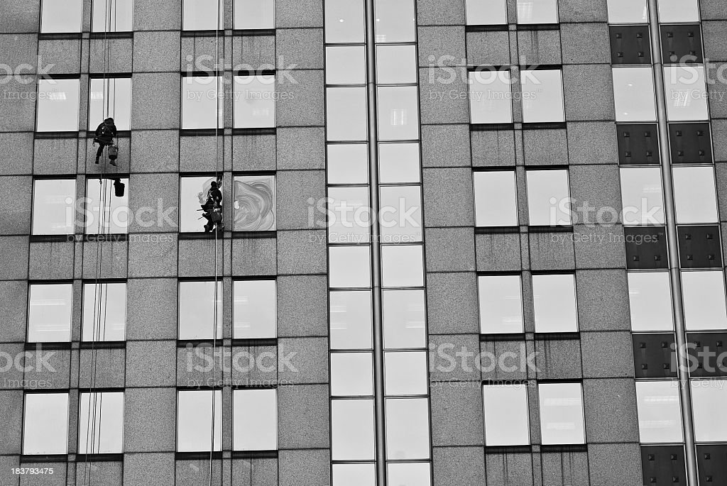 Workers cleaning windows of building stock photo
