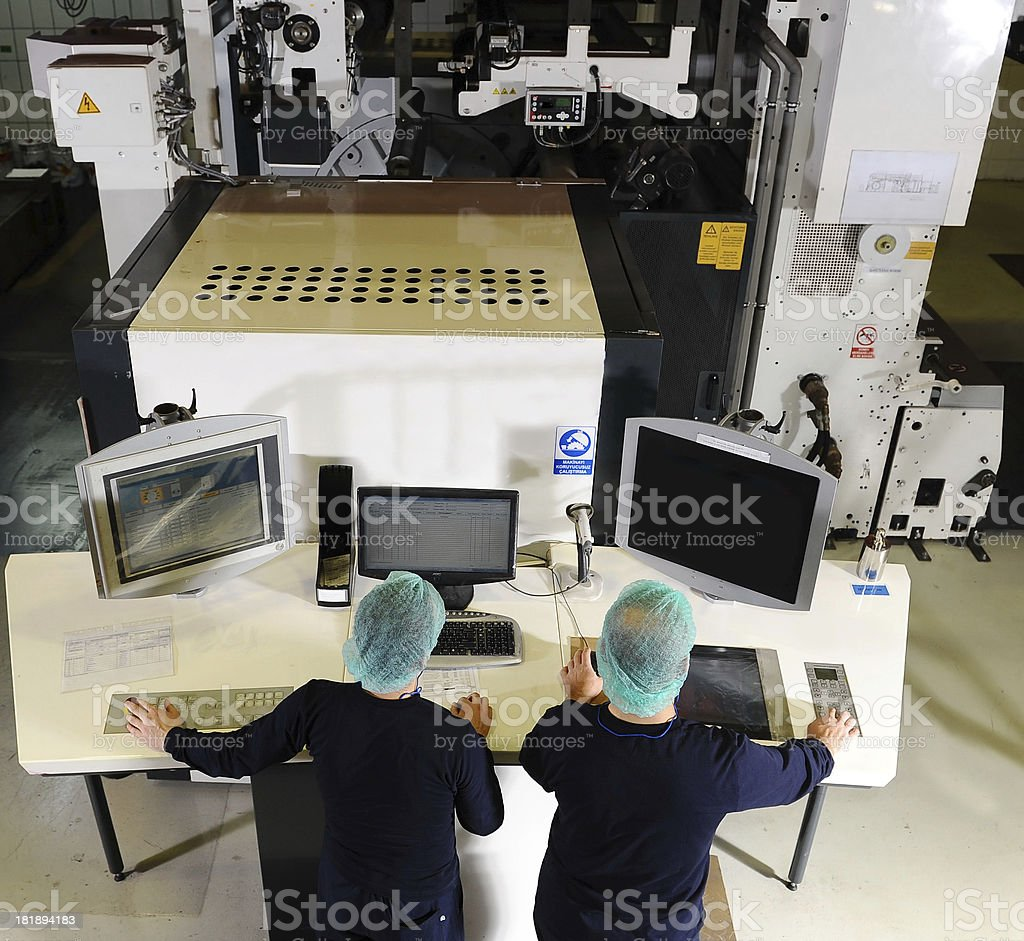 Workers controlling production process royalty-free stock photo