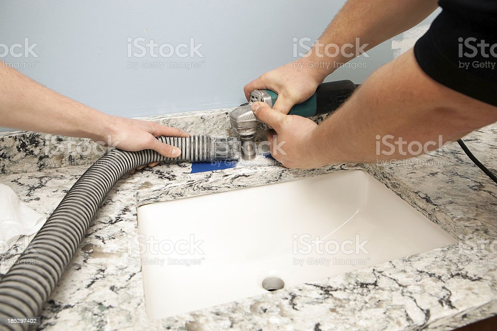 Workers Cut New Countertop for Faucet royalty-free stock photo