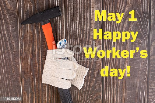 istock Workers' day background concept - many handy tools, notebook with happy workers' day text , wooden background, top view 1219190034