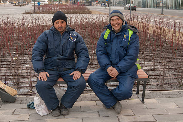 workers from middle asia in russia - gold tooth stock photos and pictures