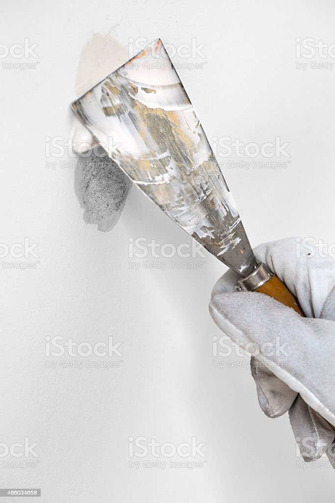 Worker's Hand and Spatula - Stock Image stock photo