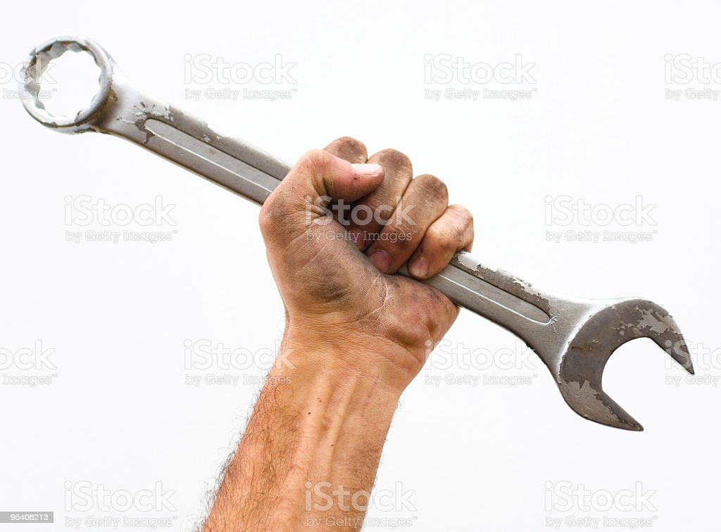 Workers hand and wrench. stock photo