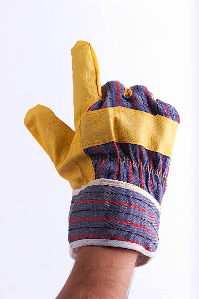 worker's hand zeigt etwas - arbeitshandschuhe stock-fotos und bilder