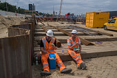 Roermond, the Netherlands, - June 20, 2019. Workers having a break in the preparation for making a new tunnel in the city center.