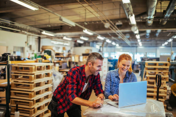 workers in a printing factory - distribution warehouse stock photos and pictures