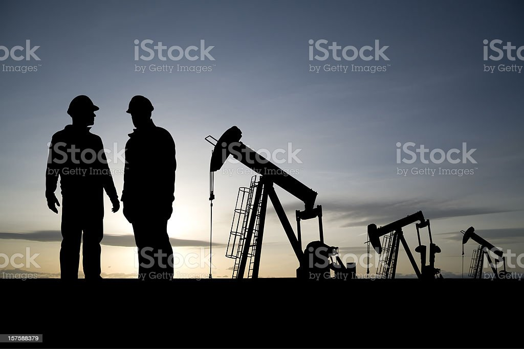 Workers in an Oil Field royalty-free stock photo