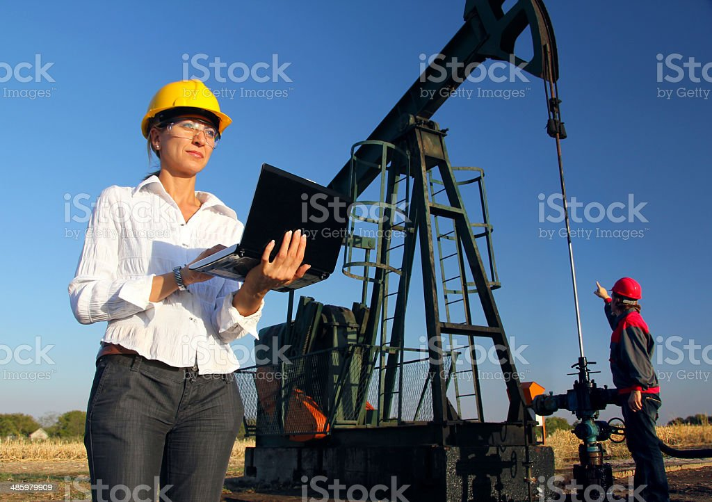 Workers in an Oilfield, teamwork stock photo