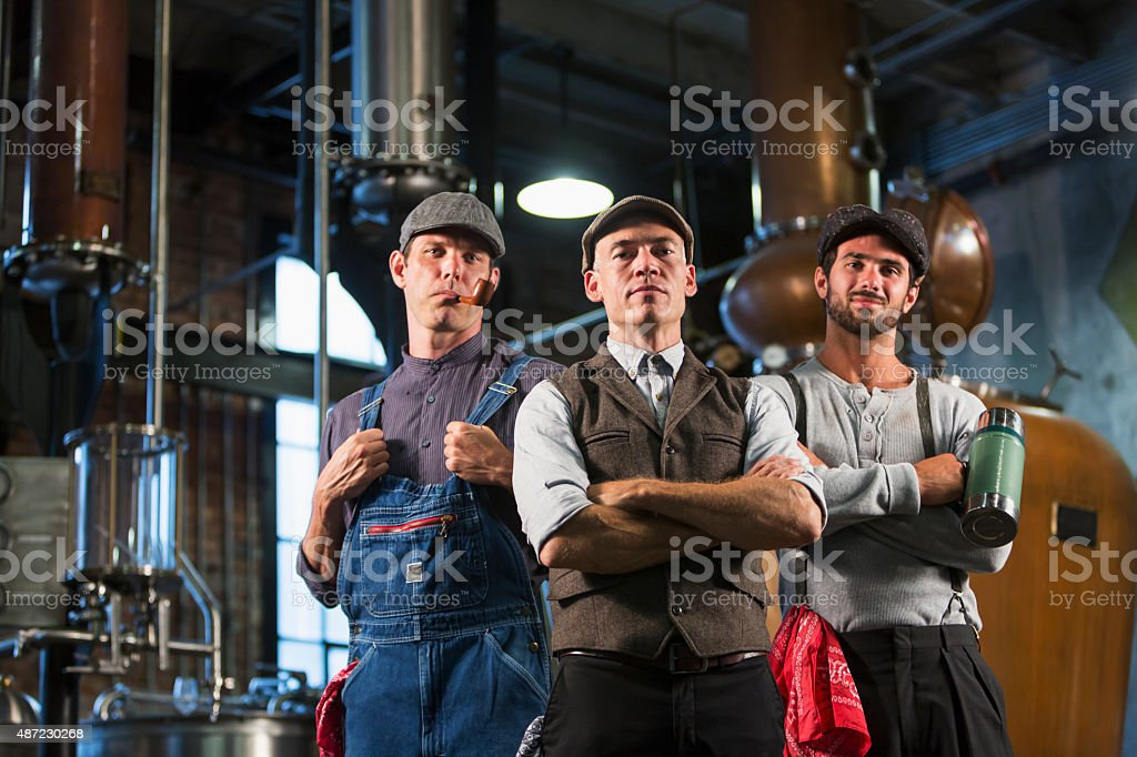 Workers in an old distillery stock photo