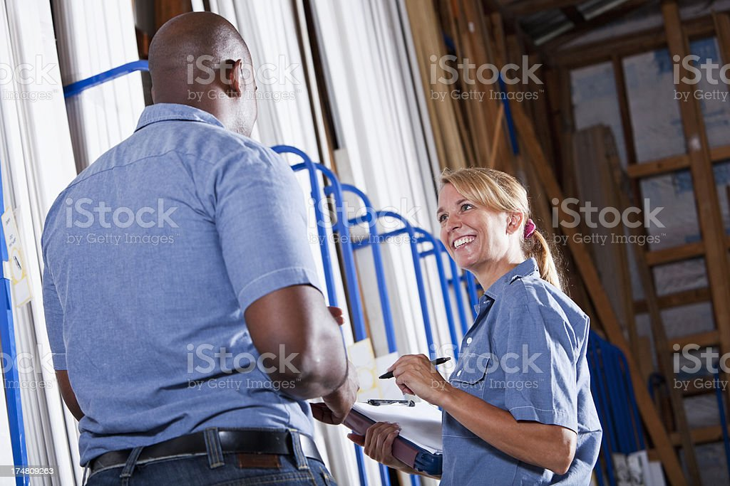 Workers in building supply store taking inventory stock photo
