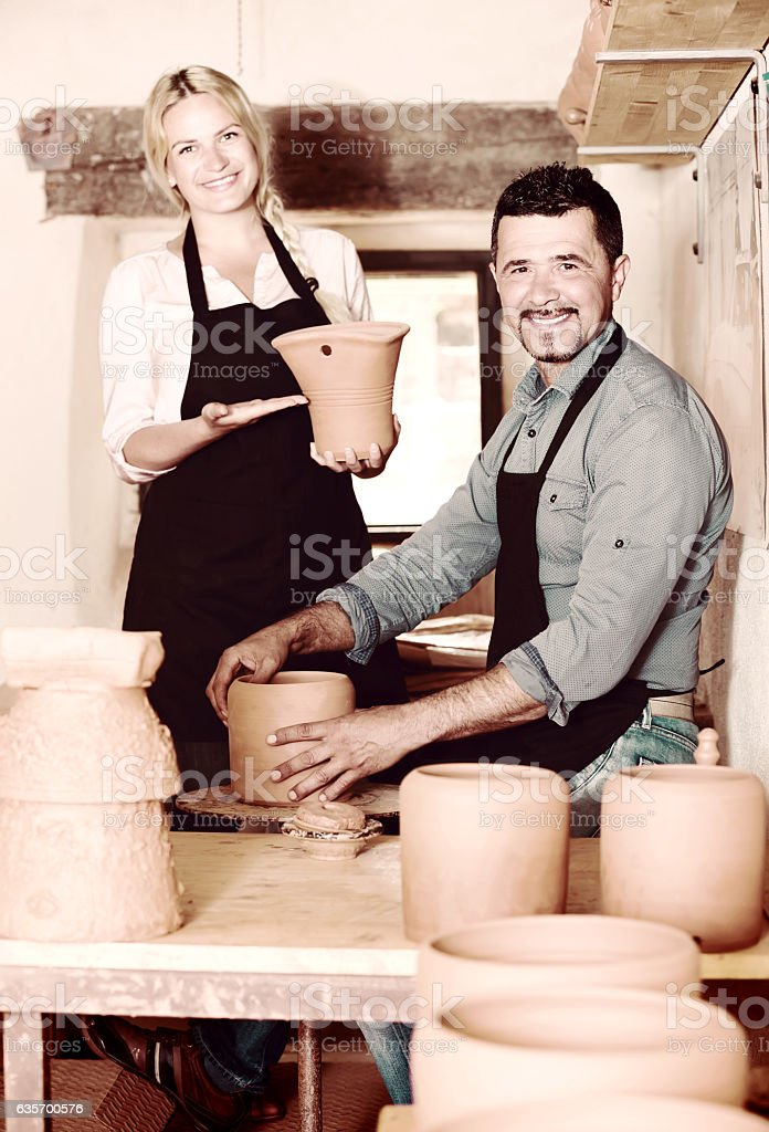 Workers in ceramics workshop with pottery wheel royalty-free stock photo