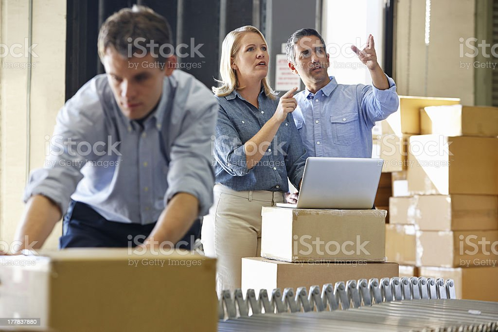 Workers In Distribution Warehouse stock photo