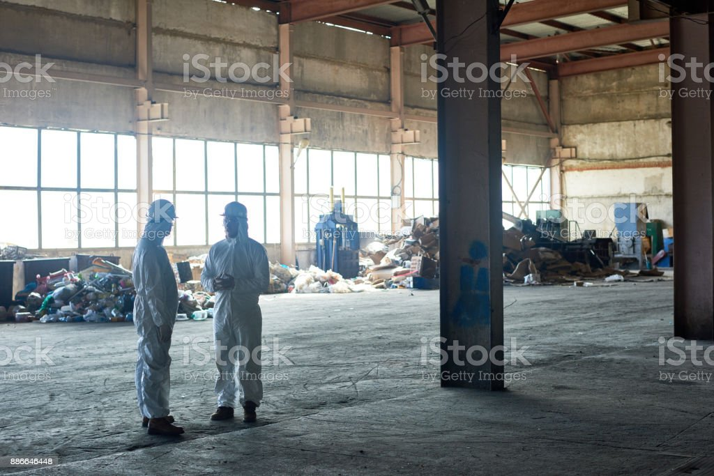 Workers in Empty Waste Processing Workshop stock photo