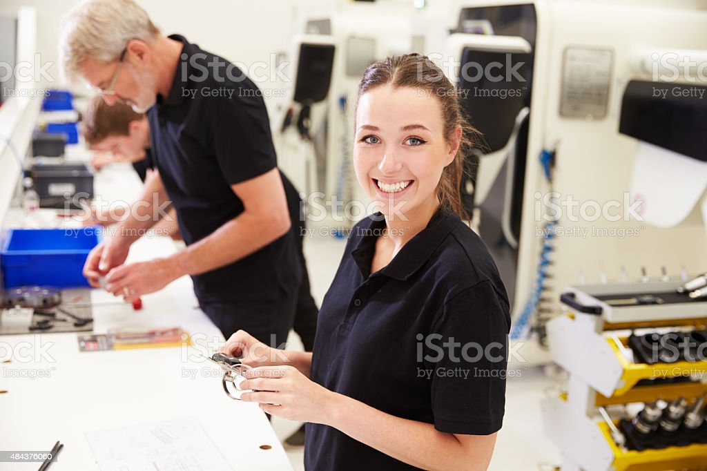 Workers In Engineering Factory Checking Component Quality - Royalty-free 20-29 Years Stock Photo