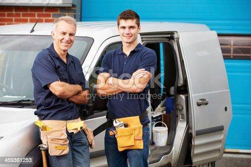 istock Workers In Family Business Standing Next To Van 459361253