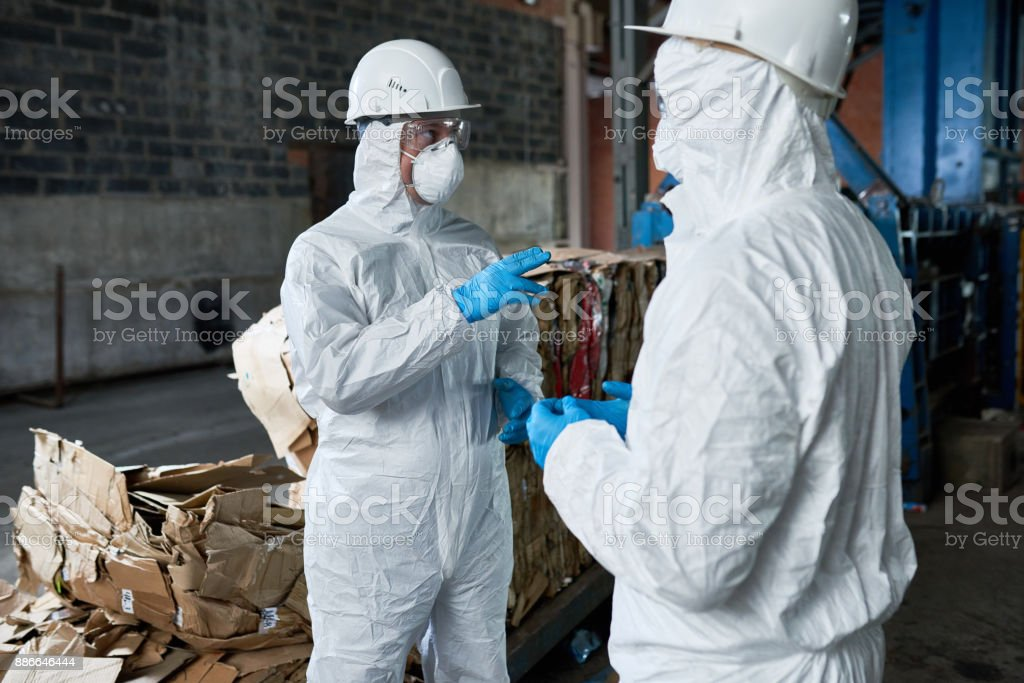 Workers in Recycling Plant Warehouse stock photo