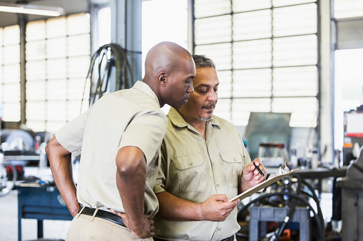 istock Workers in truck repair shop 856726524
