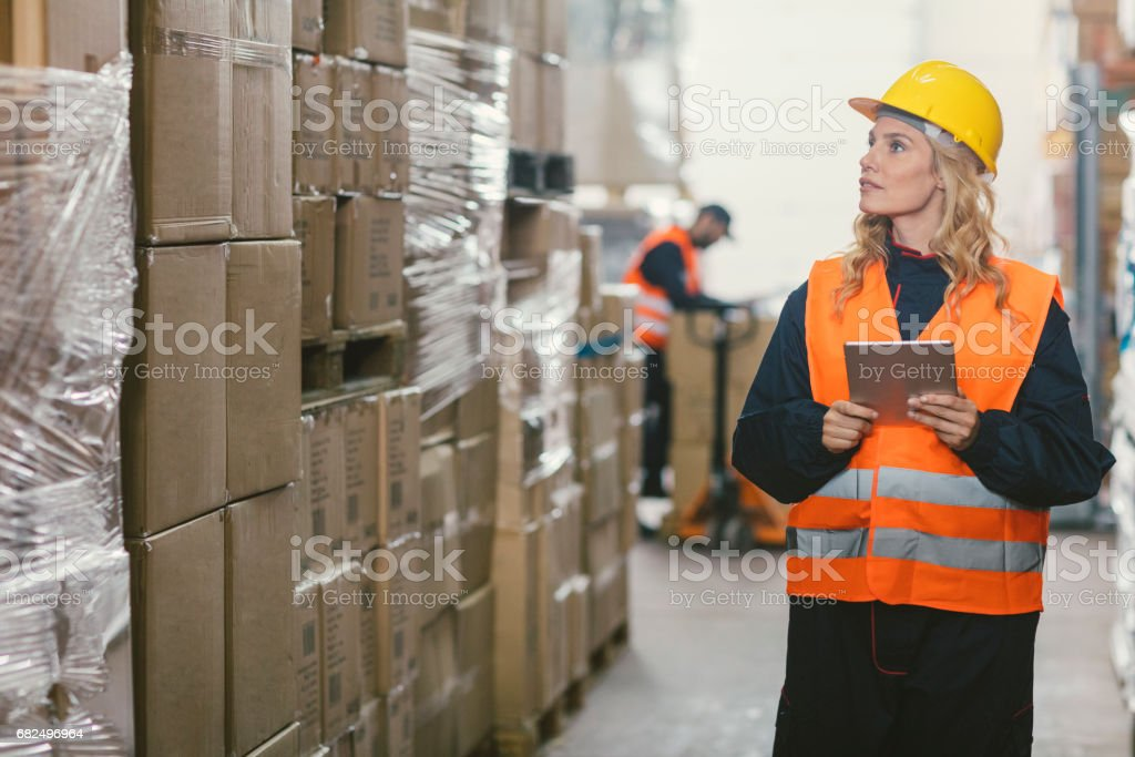 Workers in warehouse checking merchandise royalty-free stock photo