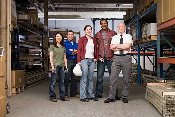 workers in warehouse - arbeider stockfoto's en -beelden