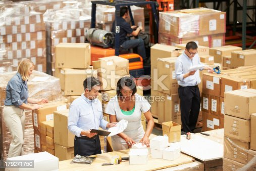 istock Workers In Warehouse Preparing Goods For Dispatch 179271750
