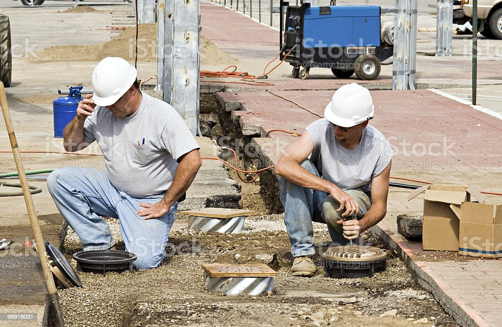 Workers Installing Lights royalty-free stock photo