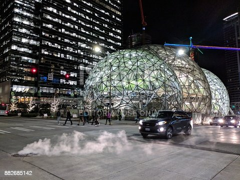 496586115 istock photo Workers Leave the Offices Outside Amazon Headquarters and Biosphere Domes 882685142