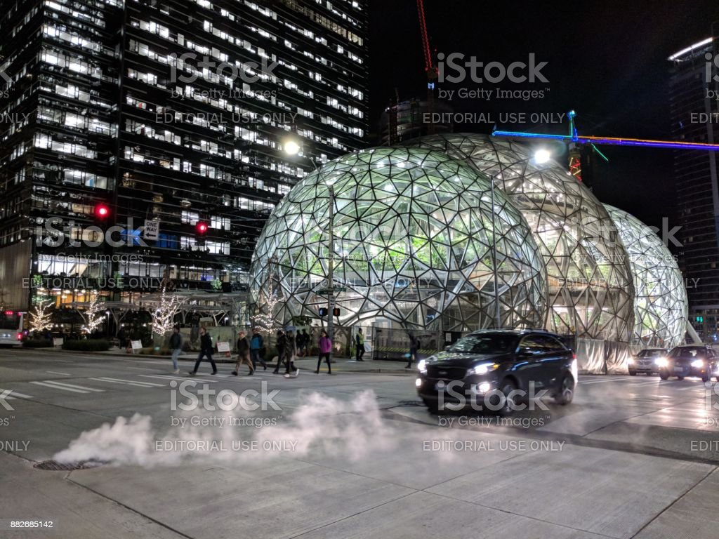 Workers Leave the Offices Outside Amazon Headquarters and Biosphere Domes stock photo