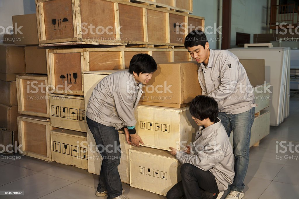 workers move wooden boxes royalty-free stock photo