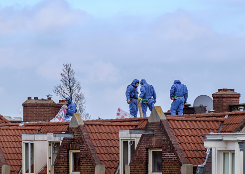 istock Workers on a roof 918535608