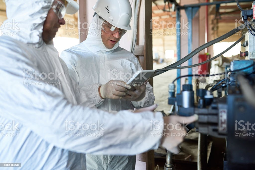 Workers on Biohazard Factory stock photo