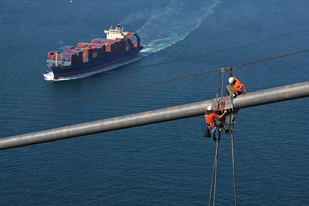 Workers on Bridge Workers try to fix the lights of bridge. rigging stock pictures, royalty-free photos & images