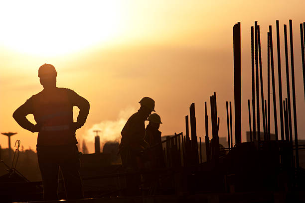 workers on construction, real human adult photo stock photo