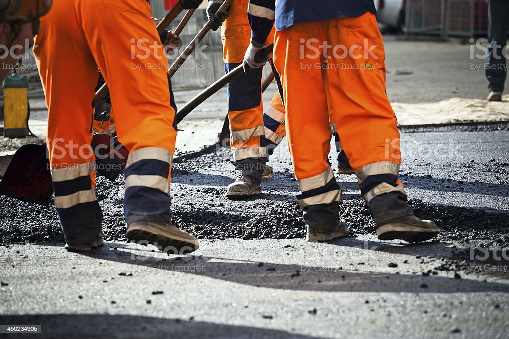 Workers on road construction stock photo