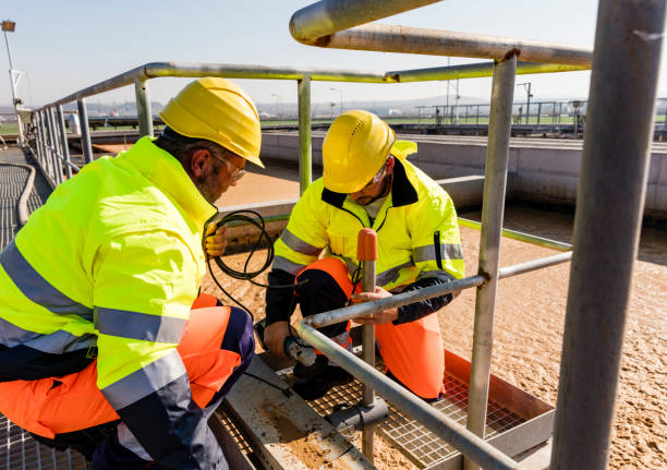 Workers on site of wastewater treatment plant stock photo