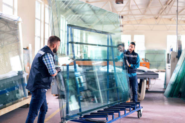 workers packaging glass sheets in warehouse - glass stock photos and pictures