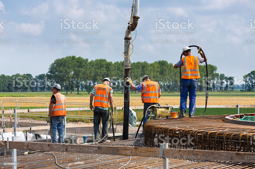 Workers preparing a concrete foundation of a Dutch wind turbine stock photo