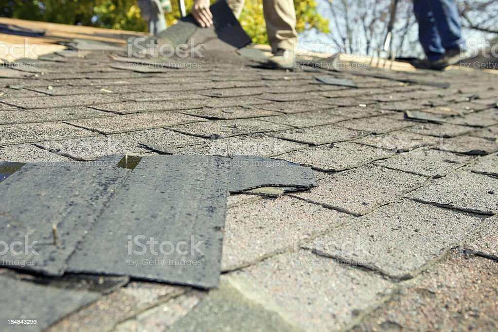 Workers Removing Old Shingle Roof for Replacement royalty-free stock photo