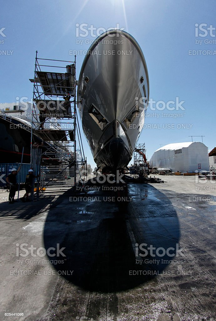 Workers repairing a boat. stock photo
