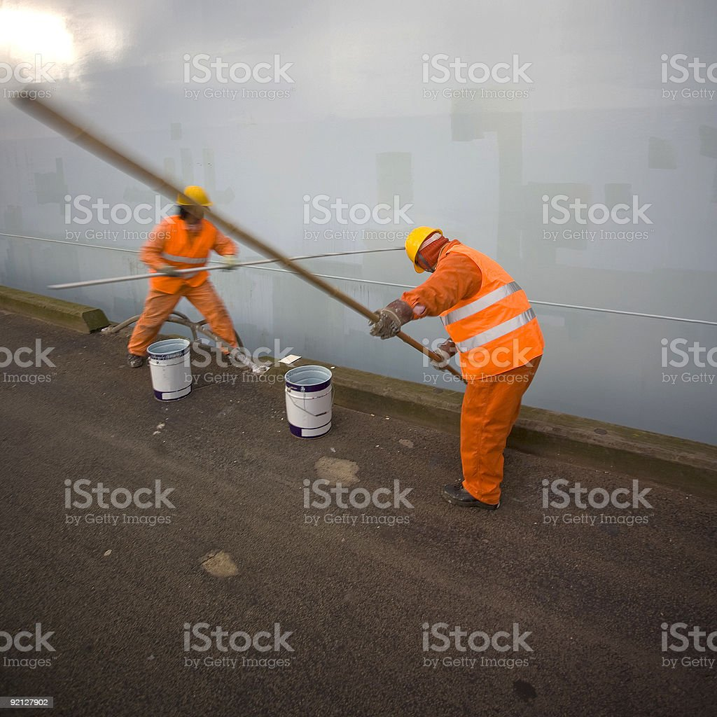 Workers repairing the paint on a container vessel royalty-free stock photo