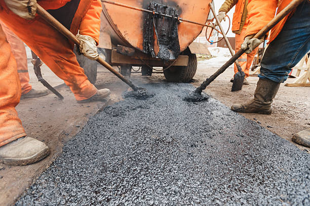 workers repairing the road with shovels fill asphalt driveway repair - asphalt stock pictures, royalty-free photos & images