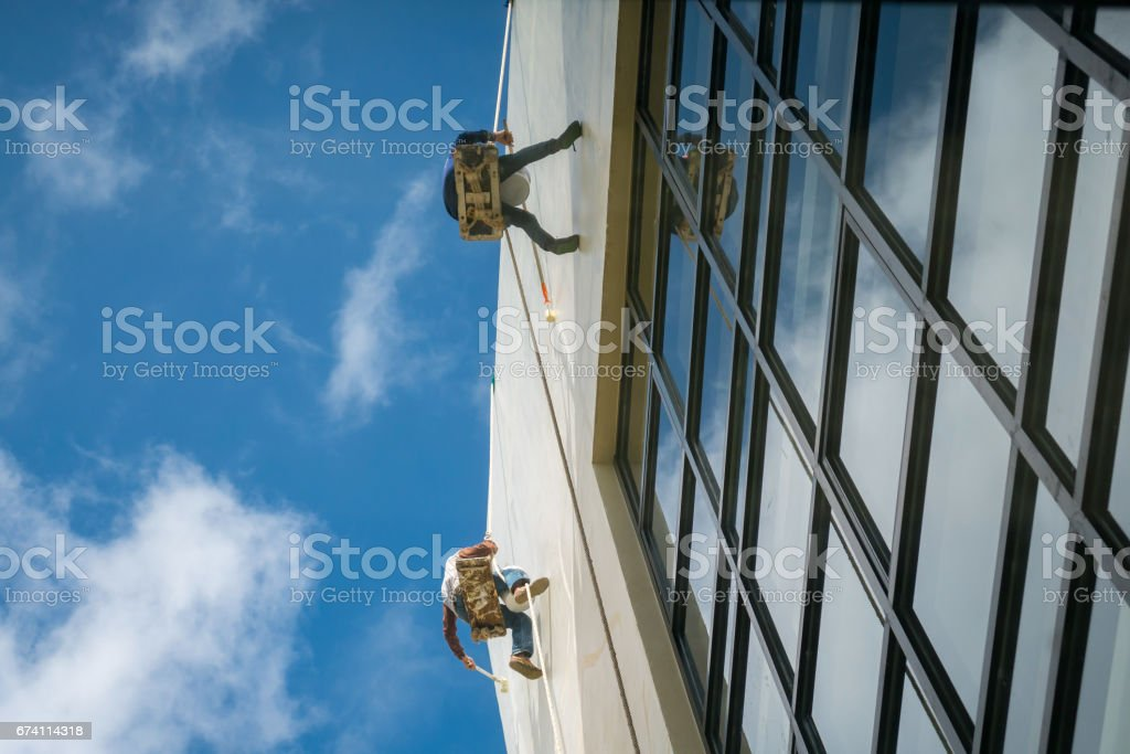 Workers repairing the wall royalty-free stock photo