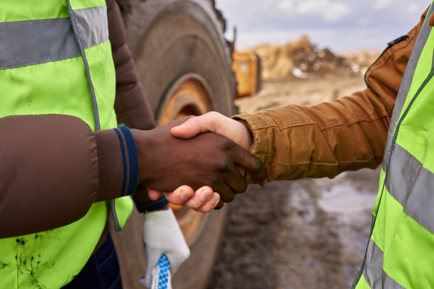 Workers Shaking Hands Outdoors Closeup stock photo