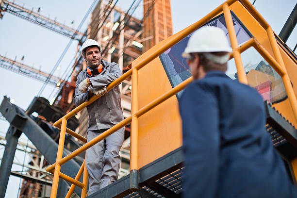 Workers talking at oil refinery  power occupation stock pictures, royalty-free photos & images
