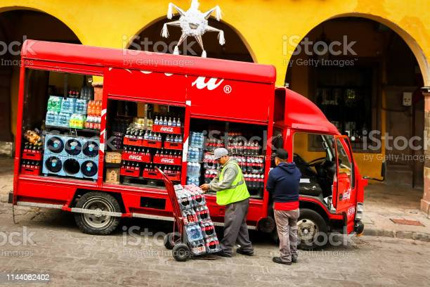 Workers unload bottles from cocacola truck in the old town picture id1144082402?b=1&k=6&m=1144082402&s=612x612&h= oaygj0r1v85o3tk5xc6rnumz7n1ytdzt51kkeh 4es=