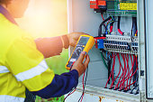 istock Workers use a Multimeter to measure the voltage of electrical wires produced from solar energy to confirm systems working normally 1192061930